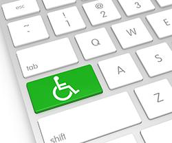 Tangentbord med rullstolssymbol på en knapp.
